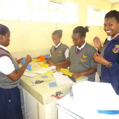 Students participating in needle work in a homescience lesson.